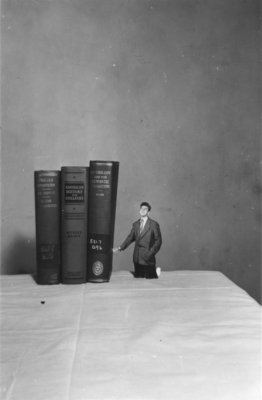 Waterloo College student with books