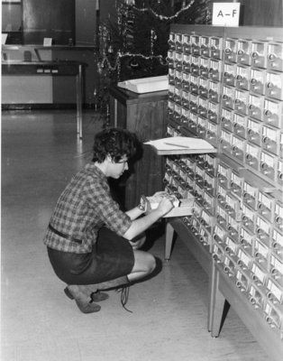Woman using card catalogue in the Waterloo Lutheran University Library