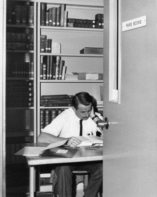 Man sitting in Rare Books room, Waterloo Lutheran University