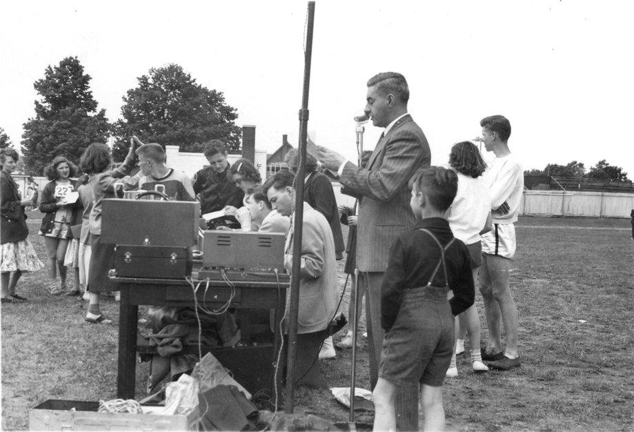 Man using public address system, Waterloo College Invitation Games, 1947
