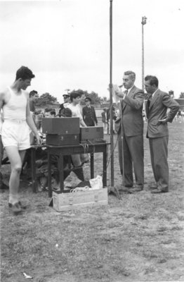 Man using public address system, Waterloo College Invitation Games, 1947