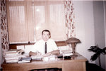 Erich Schultz sitting at desk