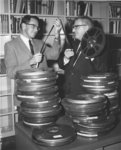 Henry Endress and Erich Schultz examining film