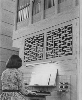 Woman playing organ in Keffer Memorial Chapel, Waterloo Lutheran Seminary