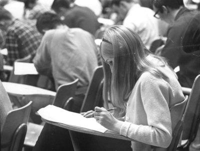 Waterloo Lutheran University student writing an exam