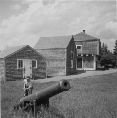 Don McNaughton standing with cannon