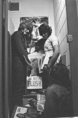 Radio Lutheran in bathroom stall