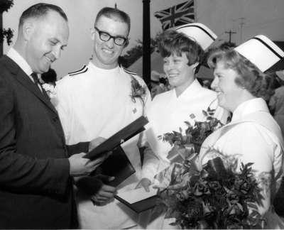 Fred Little and three nurses