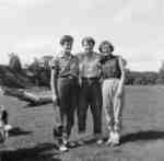 Doreen Sanderson, Dorothy Foell and Anita Fast standing in a field