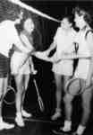 Four female badminton players shaking hands