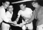 Four badminton players shaking hands