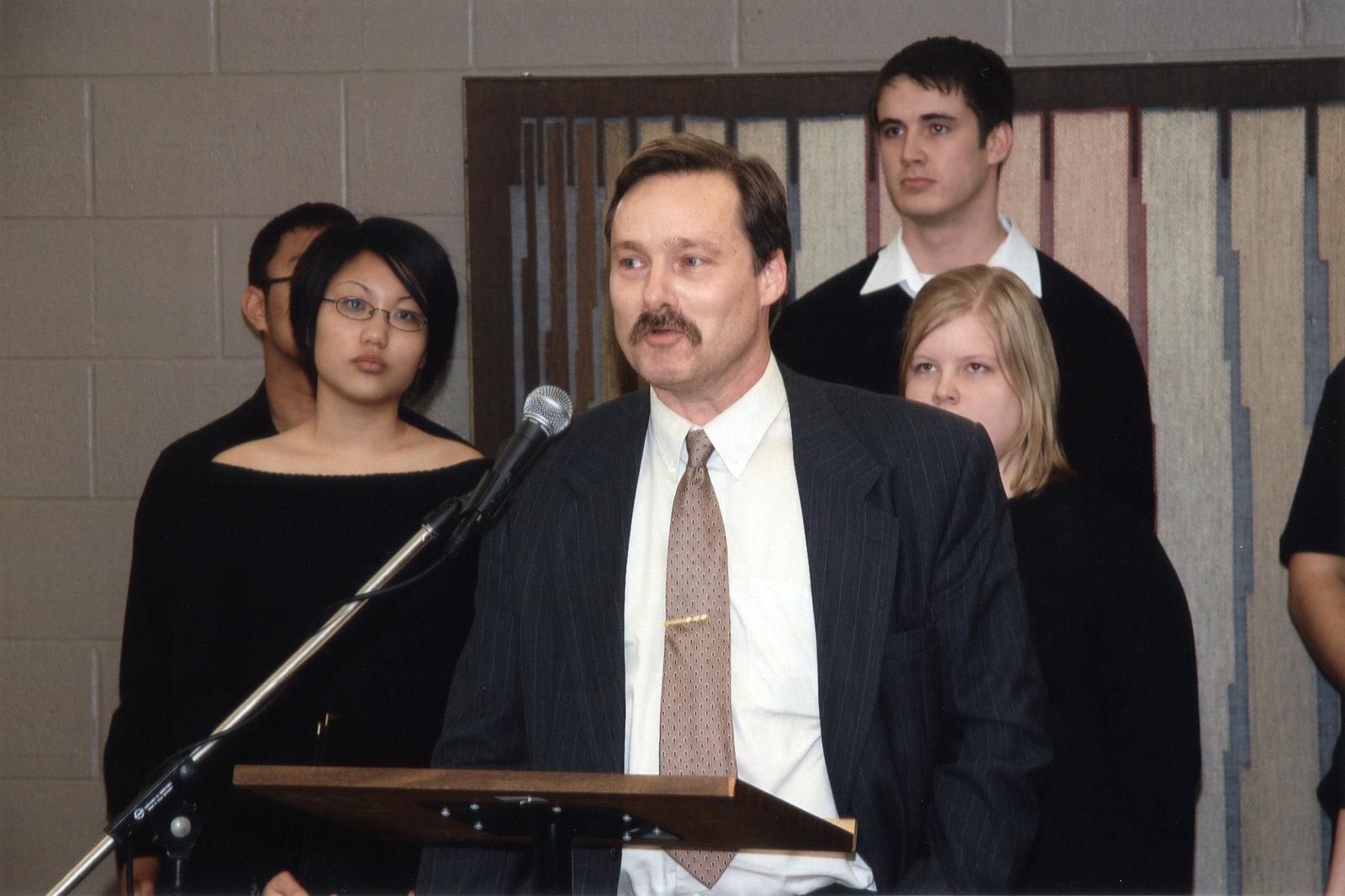 Chris Nighman speaking at unveiling of medieval manuscript