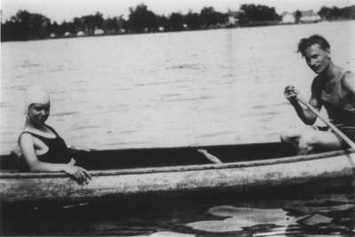 A man and a woman in a canoe
