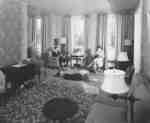 Three female Waterloo College students in Conrad Hall