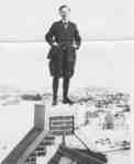 Fred Janzen standing on the roof of Willison Hall