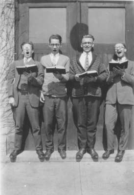 Four Waterloo College students singing