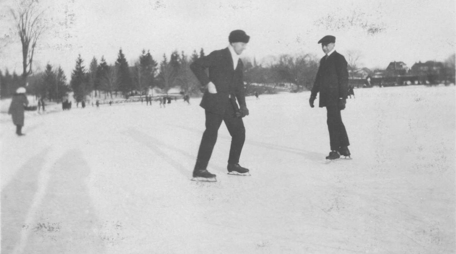 Carl Sorensen and James Vorkoper ice skating in Guelph, Ontario