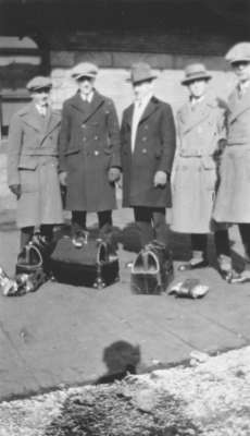 Five students standing on a platform