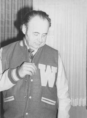 Frank Peters wearing a Lettermen jacket