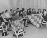 Women's Auxiliary members admiring a quilt