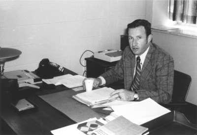 Frank Turner sitting at a desk