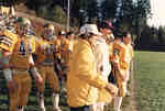 Rich Newbrough and football players during 1987 Western Bowl