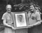 Rich Newbrough presenting portrait to Mavis Lewin