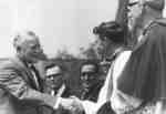 Roland Michener shaking hands with Arthur Conrad