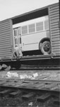 Unloading Bus from Rail Car