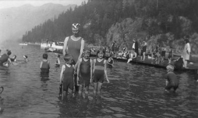 Mrs. Lunn with children swimming in Horseshoe Bay