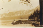 Tug boats with log booms in Horseshoe Bay in 1934