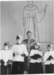 Monsignor J. E. Brown and alter boys at St. Anthony's Church