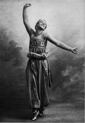 Ballet star, Vaslav Nijinsky posing as the Golden Slave in the c.1910 ballet adaptation of Scheherazade (One Thousand and One Nights, also known as Arabian Nights) composed by Nikolai Rimsky-Korsakov.