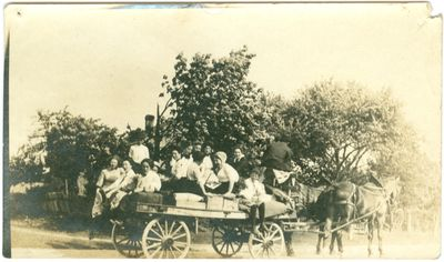 Women and Children on Flatbed Wagon
