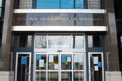 Signs on Door of Region of Waterloo Public Health and Community Services Building, Waterloo