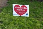 """We are in this together."" RE/MAX Lawn Sign"