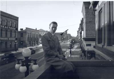 Man Sitting on Balcony, King Street