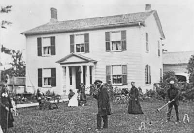 Several people playing croquet in front of the residence of Richard Hatch, c.1878