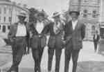 Group of men standing on Brock Street.