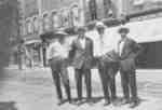 Group of men standing on Brock Street