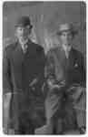 An unidentified man standing with Ernest John Ellis
