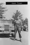 Photo of Jack Town standing in front of a truck