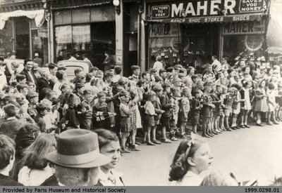 Pupils watching a military parade about 1942