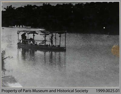Robert West taking a customer out in his bicycle boat on the Nith River mill-pond, c. 1915-17