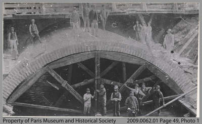Workers by the raceway and waterwheel under the Grand River, c. 1885