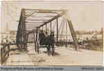Postcard depicting Penman driving across the William St. Bridge, c. early 20th century