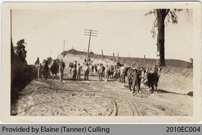 Workers building Highway 24 near Perry German's Farm