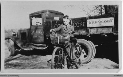 Sam King on Bicycle by S C King Coal Truck, Scotland, Ontario