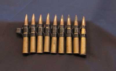 Ammunition cartridges on a belt for a machine gun