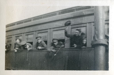 Soldiers waving from a train